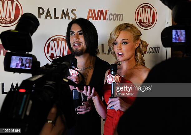 Recording artist Dave Navarro interviews adult film actress Kayden Kross as she arrives at the 28th annual Adult Video News Awards Show at the Palms...