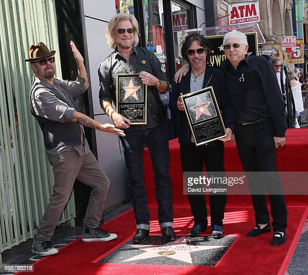Recording artist Dave Stewart recording artists Daryl Hall and John Oates of Hall Oates and music executive Jerry Greenberg attend Daryl Hall and...