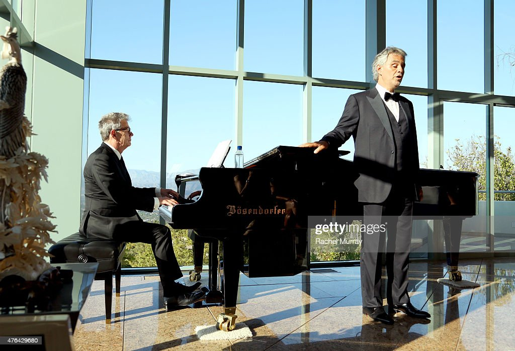 Recording Artist David Foster and Maestro Andrea Bocelli perform a private concert for guests during Alfred Mann Foundation's an Evening Under The Stars with Andrea Bocelli on June 8, 2015 in Los Angeles, California.