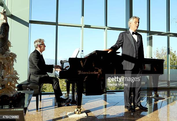 Recording Artist David Foster and Maestro Andrea Bocelli perform a private concert for guests during Alfred Mann Foundation's an Evening Under The...