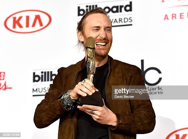 Recording artist David Guetta, winner of the Top Dance/Electronic Artist award, poses in the press room during the 2016 Billboard Music Awards at...