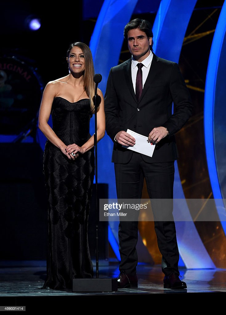 Recording artist Debi Nova (L) and actor Daniel Arenas present an award onstage during the 15th Annual Latin GRAMMY Awards at the MGM Grand Garden Arena on November 20, 2014 in Las Vegas, Nevada.