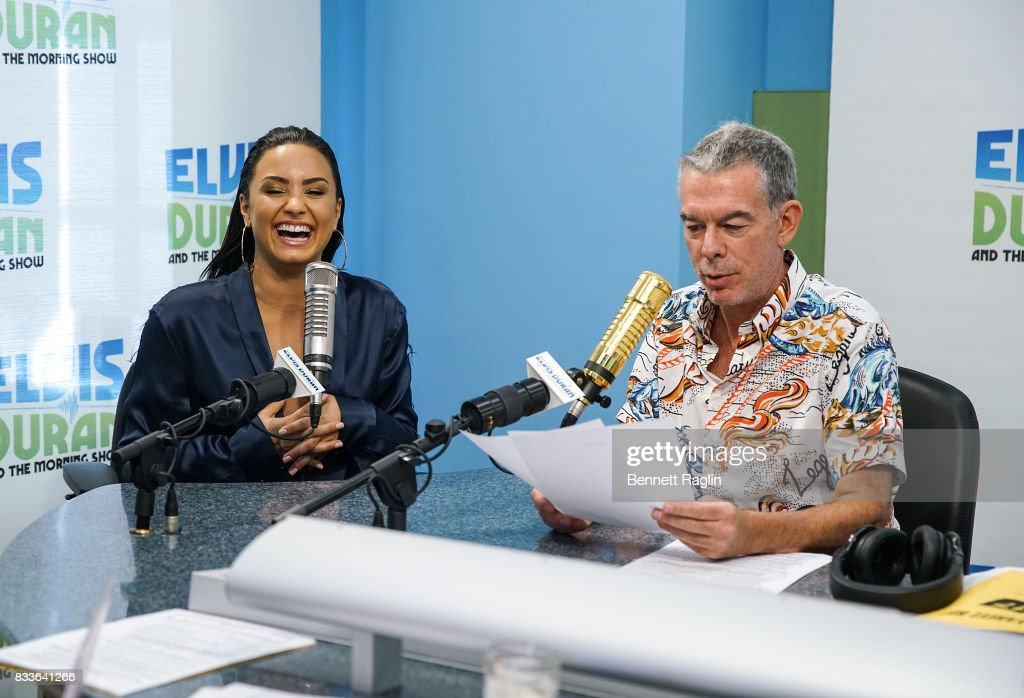 Recording artist Demi Lovato (L) and radio host Elvis Duran visit 'The Elvis Duran Z100 Morning Show' to discuss her upcoming album at Z100 Studio on August 17, 2017 in New York City.