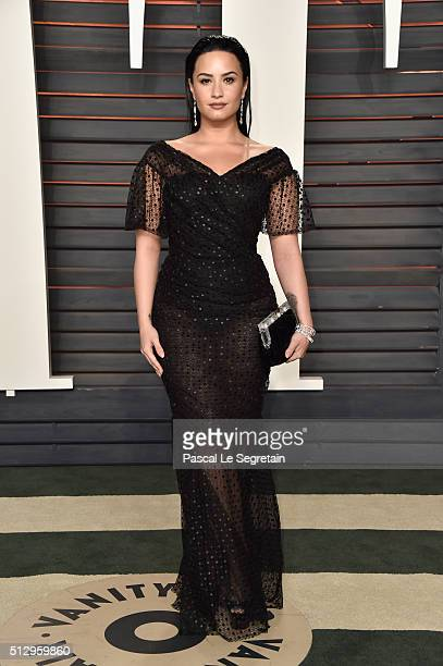 Recording artist Demi Lovato attends the 2016 Vanity Fair Oscar Party Hosted By Graydon Carter at the Wallis Annenberg Center for the Performing Arts...