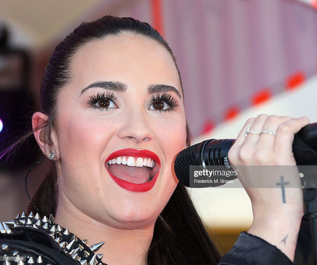 Recording artist Demi Lovato performs during Topshop Topman LA Grand Opening at The Grove on February 14, 2013 in Los Angeles, California.