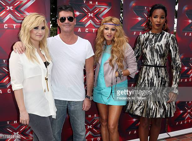 Recording artist Demi Lovato producer Simon Cowell recording artists Paulina Rubio and Kelly Rowland attend Fox's 'The X Factor' Judges at the Galen...