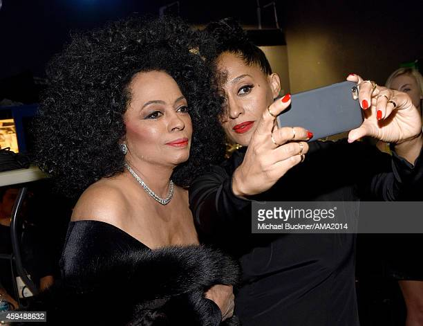 Recording artist Diana Ross and actress Tracee Ellis Ross take a selfie at the 2014 American Music Awards at Nokia Theatre LA Live on November 23...