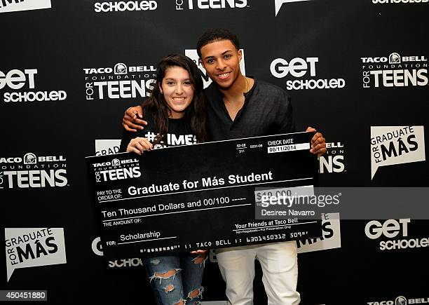 Recording artist Diggy poses with contest winner Ariana Elle Medina at the 2nd Annual Get Schooled Times Square Yearbook Unveiling at Viacom Building...