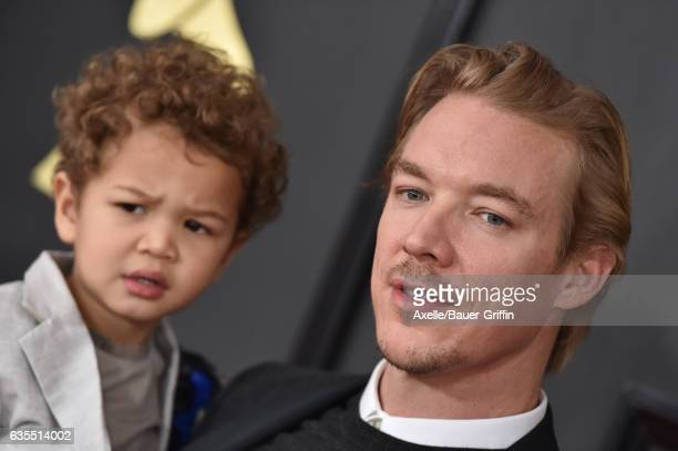Recording artist Diplo and son Lazer Pentz attend the 59th GRAMMY Awards at STAPLES Center on February 12 2017 in Los Angeles California