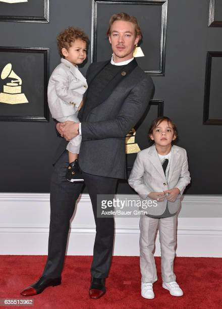 Recording artist Diplo sons Lazer Pentz and Lockett Pentz attend the 59th GRAMMY Awards at STAPLES Center on February 12 2017 in Los Angeles...