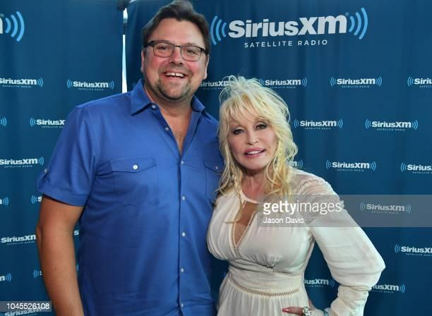Recording Artist Dolly Parton poses with SiriusXM host Storme Warren at SiriusXM Nashville Studios at Bridgestone Arena on October 4 2018 in...