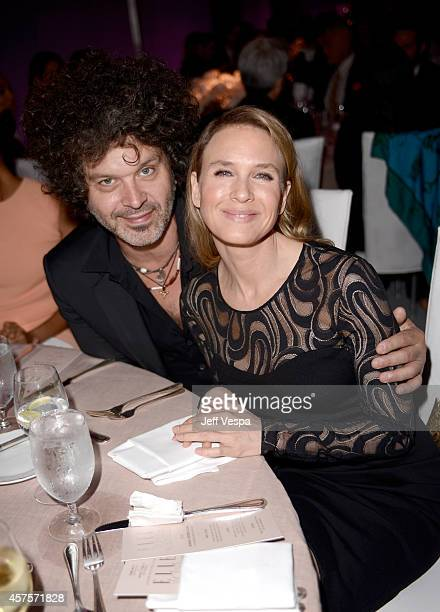 Recording artist Doyle Bramhall II and actress Renee Zellweger attend ELLE's 21st Annual Women in Hollywood Celebration at the Four Seasons Hotel on...