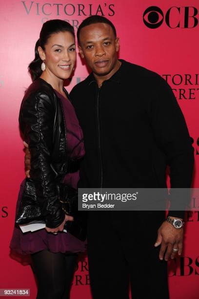 Recording artist Dr Dre and his wife Nicole Young arrives at the Victoria's Secret fashion show at The Armory on November 19 2009 in New York City