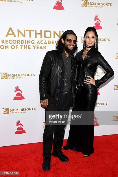 Recording artist Draco Rosa and actress/director Angela Alvarado attend the 2016 Person of the Year honoring Marc Anthony at MGM Grand Garden Arena...