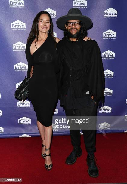 Recording artist Draco Rosa and wife Angela Alvarado attend the 100 Roofs Gala at Conga Room on September 20 2018 in Los Angeles California