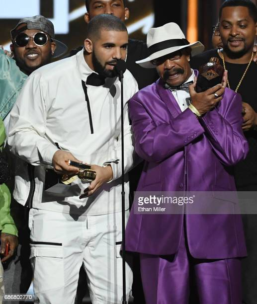 Recording artist Drake accepts the Top Artist award with his father Dennis Graham during the 2017 Billboard Music Awards at TMobile Arena on May 21...