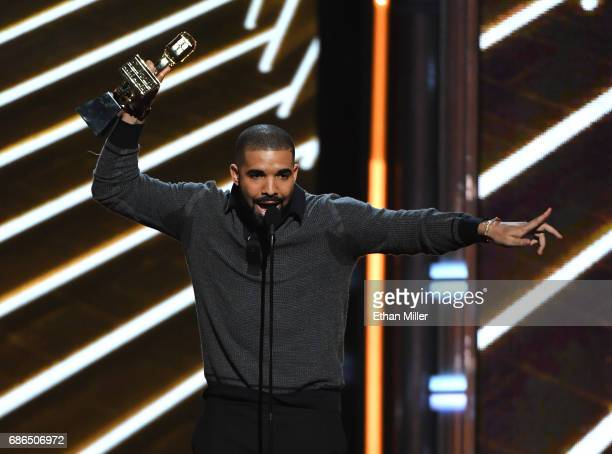 Recording artist Drake accepts the Top Billboard 200 Album award for 'Views' onstage during the 2017 Billboard Music Awards at TMobile Arena on May...