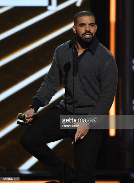 Recording artist Drake accepts the Top Billboard 200 Album award for Views onstage during the 2017 Billboard Music Awards at TMobile Arena on May 21...