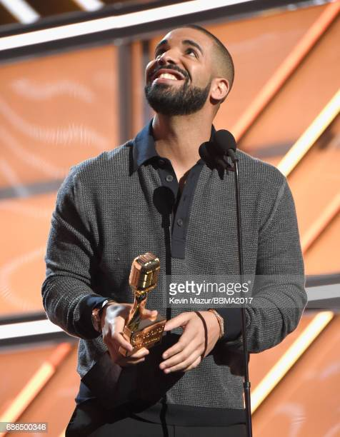 Recording artist Drake accepts the Top Male Artist award onstage during the 2017 Billboard Music Awards at TMobile Arena on May 21 2017 in Las Vegas...