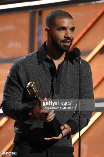 Recording artist Drake accepts the Top Male Artist award onstage during the 2017 Billboard Music Awards at T-Mobile Arena on May 21, 2017 in Las...
