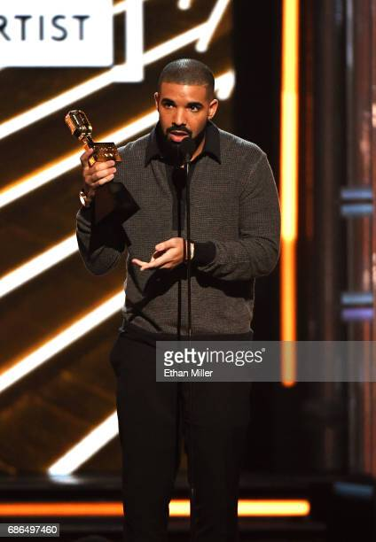 Recording artist Drake accepts Top Male Artist award onstage during the 2017 Billboard Music Awards at TMobile Arena on May 21 2017 in Las Vegas...