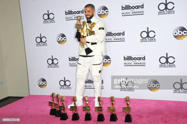Recording artist Drake poses with awards in the press room during 2017 Billboard Music Awards at TMobile Arena on May 21 2017 in Las Vegas Nevada