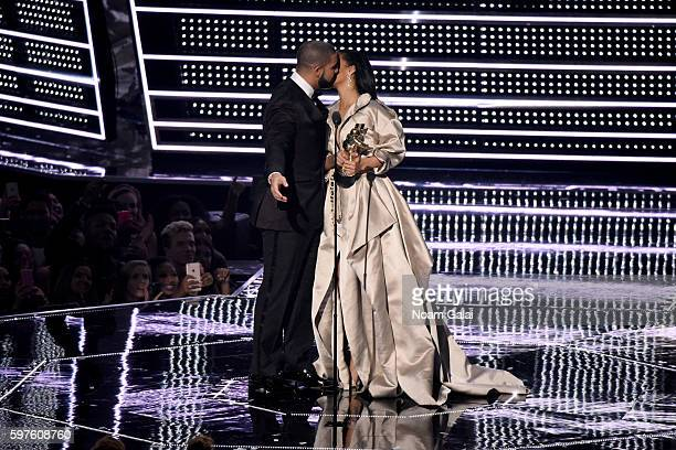 Recording artist Drake presents the Michael Jackson Video Vanguard Award to recipient Rihanna onstage during the 2016 MTV Video Music Awards at...