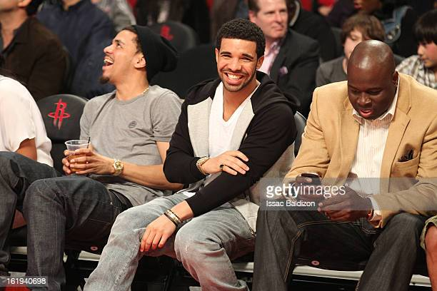 Recording Artist Drake smiles as he watches the game from courtside during 2013 NBA AllStar Game on February 17 2013 at Toyota Center in Houston...