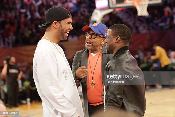 Recording artist Drake talks with director Spike Lee and comedian Kevin Hart during the Foot Locker ThreePoint Contest on State Farm AllStar Saturday...