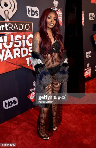 Recording artist Dreezy attends the 2017 iHeartRadio Music Awards which broadcast live on Turner's TBS TNT and truTV at The Forum on March 5 2017 in...