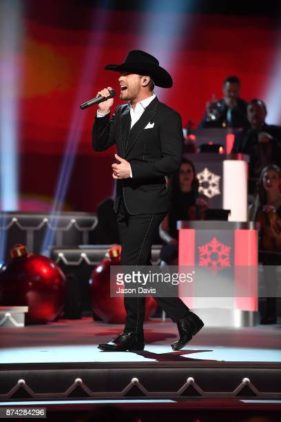 Recording Artist Dustin Lynch performs on stage during 2017 CMA Country Christmas at The Grand Ole Opry on November 14 2017 in Nashville Tennessee