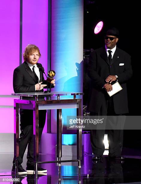 Recording artist Ed Sheeran accepts the award for Best Pop Solo Performance for 'Thinking Out Loud' alongside record producer Jimmy Jam onstage...