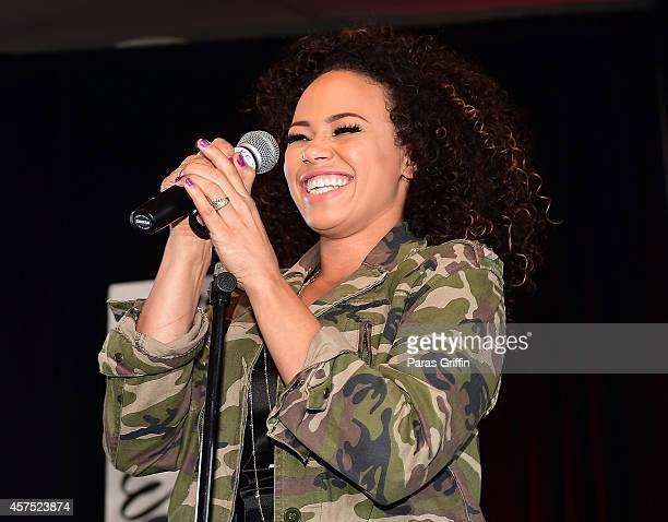 Recording artist Elle Varner performs onstage at the V103 Acoustic Sunday Featuring Elle Varner at The W Hotel Midtown on October 19 2014 in Atlanta...