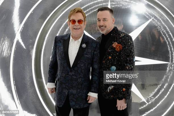Recording artist Elton John and David Furnish attend the 25th Annual Elton John AIDS Foundation's Academy Awards Viewing Party at The City of West...