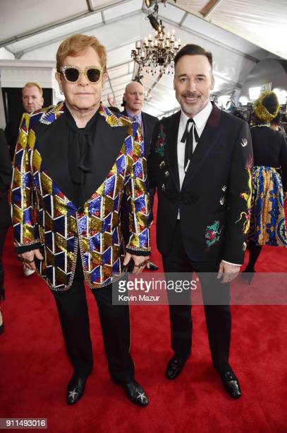 Recording artist Elton John and David Furnish attend the 60th Annual GRAMMY Awards at Madison Square Garden on January 28 2018 in New York City