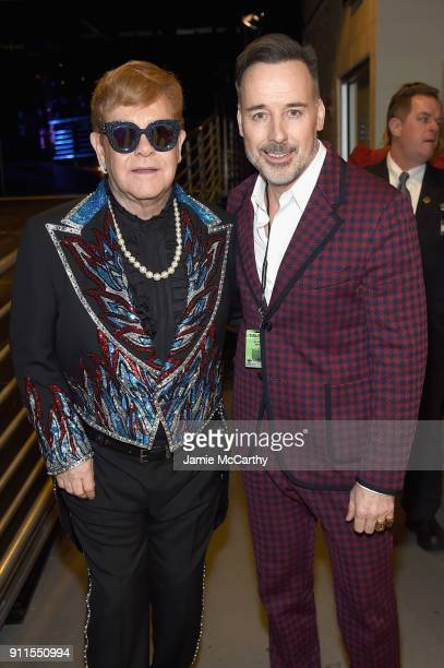 Recording artist Elton John and David Furnish backstage at the 60th Annual GRAMMY Awards at Madison Square Garden on January 28 2018 in New York City