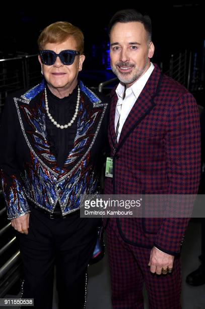 Recording artist Elton John and David Furnish pose backstage during the 60th Annual GRAMMY Awards at Madison Square Garden on January 28 2018 in New...