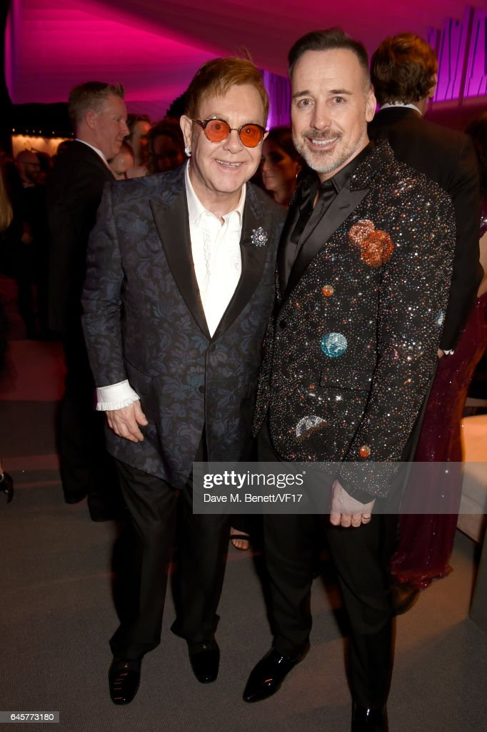 Recording artist Elton John (L) and director David Furnish attend the 2017 Vanity Fair Oscar Party hosted by Graydon Carter at Wallis Annenberg Center for the Performing Arts on February 26, 2017 in Beverly Hills, California.
