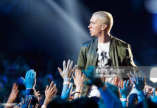 Recording artist Eminem performs onstage at the 2014 MTV Movie Awards at Nokia Theatre LA Live on April 13 2014 in Los Angeles California