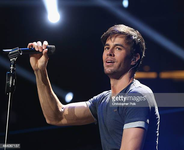 Recording artist Enrique Iglesias performs onstage during KIIS FM's Jingle Ball 2013 at Staples Center on December 6 2013 in Los Angeles CA