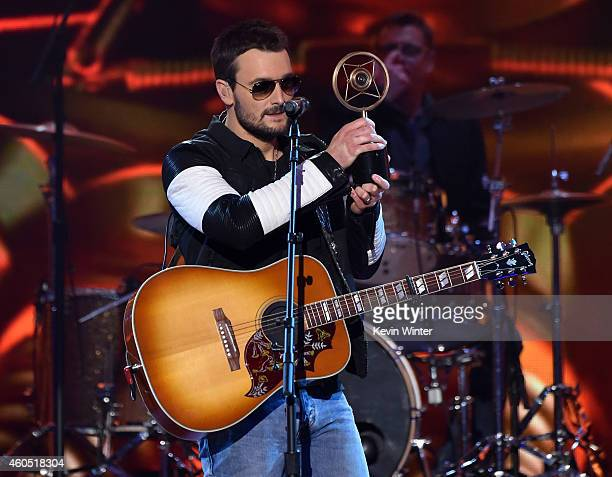 Recording artist Eric Church accepts the Album of the Year award for 'The Outsiders' onstage during the 2014 American Country Countdown Awards at...