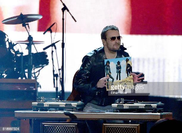 Recording artist Eric Church holds the jacket to Motorhead 'Ace of Spades' album as he performs onstage during the 51st Academy of Country Music...