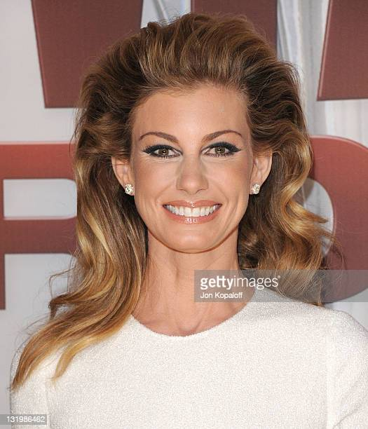 Recording artist Faith Hill arrives at the 45th annual CMA Awards at the Bridgestone Arena on November 9 2011 in Nashville Tennessee