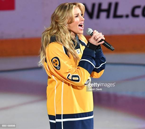 Recording Artist Faith Hill performs the National Anthem at the 2017 NHL Stanley Cup Finals Game 6 at Bridgestone Arena on June 11 2017 in Nashville...