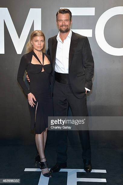 Recording artist Fergie and actor Josh Duhamel both wearing TOM FORD attends the TOM FORD Autumn/Winter 2015 Womenswear Collection Presentation at...