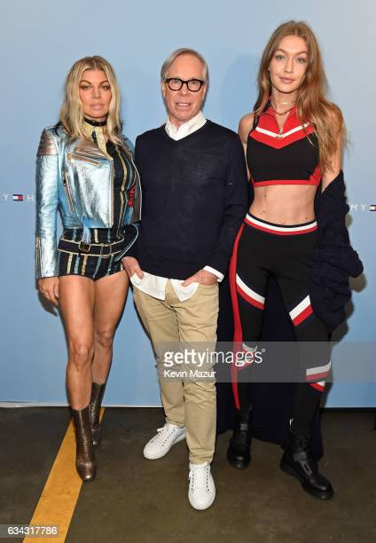 Recording artist Fergie fashion designer Tommy Hilfiger and model Gigi Hadid pose at the TommyLand Tommy Hilfiger Spring 2017 Fashion Show on...