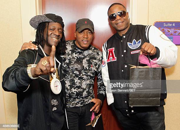 Recording artist Flavor Flav Clark County Nevada Commissioner Lawrence Weekly and recording artist Doug E Fresh attend day 1 of the 2014 Soul Train...