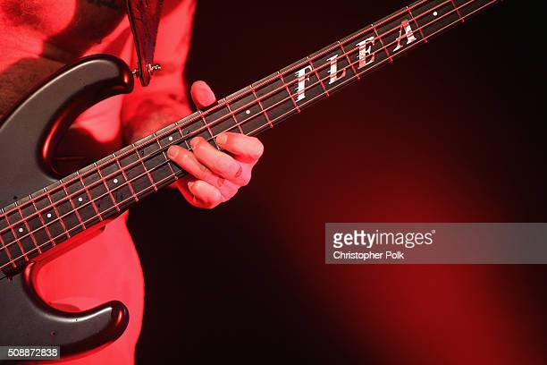 Recording artist Flea bass guitar fretboard and tattoo details of Red Hot Chili Peppers performs onstage during DirecTV Super Saturday Night cohosted...
