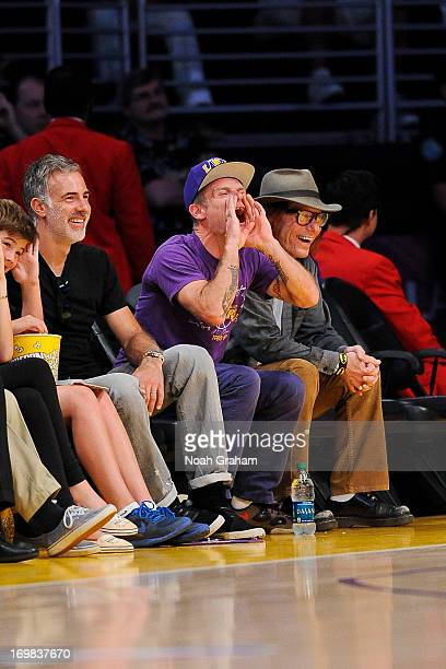 Recording artist Flea of the band Red Hot Chili Peppers cheers on the Los Angeles Lakers against the San Antonio Spurs in Game Four of the Western...