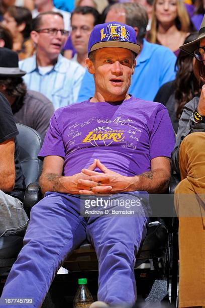 Recording artist Flea of the band Red Hot Chili Peppers looks on as the San Antonio Spurs play the Los Angeles Lakers in Game Four of the Western...